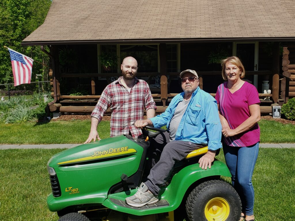 Mark Smith with Bob & Pam Kren in front of their home